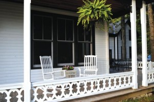 A finished section of the porch shows the warm, welcoming impact of the elegant original design, created from a simple pattern of curvaceous X's and O's.