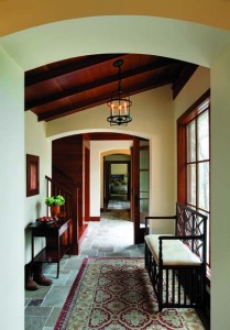 Entryway with stone floor leading into gallery