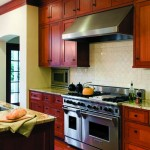 The kitchen cabinets are also vertical-grain fir, stained a warm tone.