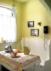 A restored period toaster and telephone lend authenticity to the breakfast nook.