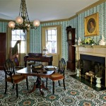 In the best parlor, carpeting laid wall to wall is a documented Regency pattern from the early decades of the 19th century.