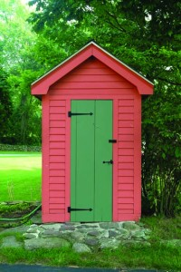 Red garden shed with iron strap hinges