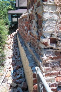 Though the bulk of many historic brick walls are composed of common brick that is hidden from view, what we see on the exterior is a layer of veneer brick—here peeled off the wall. (Photo: Nancy Snyder)