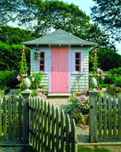 Shingled garden shed with pink door