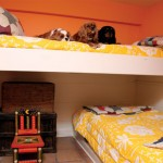 The clever bunk room is enjoyed by grandchildren—not to mention by the four King Charles spaniels.