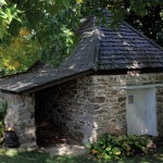 The stone icehouse is one of the original 18th-century structures on the property.