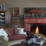 This fireplace is in a living room addition built by previous owners in 1990. The wood fish over the mantel is a fine example of an early trade sign. Pieces displayed in the corner cupboard are the work of contemporary Virginia potter Merrill Strange.