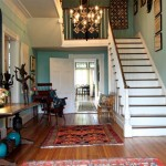 Old orientals cover wide-plank pine floors original to the 1810 section of the house. The chair in the corner is a fine piece from the early 19th century. A traditional Queen Anne desk is at home with an American quilt dated 1938 and more recent Haitian folk art.