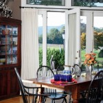 At the other end of the living room, French doors provide a view of the Blue Ridge Mountains, so much like the vista the Porter family enjoyed more than 200 years ago. The cupboard is a 19th-century family piece, and the farm table comes from the Shenandoah Valley.