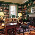 Bookshelves line the library, which adjoins the dining room. The owners are looking for an antique replacement for the contemporary mantel in this room.