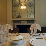 The dining room features an antique Art Deco mirror.