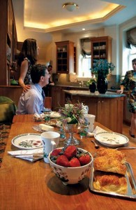 In the home's traditional kitchen (complete with Deco stepped ceiling), Randa and Greg discuss decorating plans with interior designer Dima Turkmany.