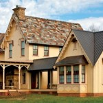 """With flushboard siding, the main block picks up Downing's high style, modeled on British medieval stone manors. Windows are """"labelled,"""" meaning they have squared wooden hoodmolds that mimic dripstones in masonry construction. The breezeway is true post-and-beam construction."""