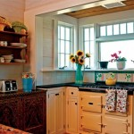 In the kitchen, the AGA cooker is one of the new dual-fuel models. The fancy cabinet is Moroccan; tiles designed by Judy were made in Argentina.