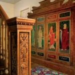 The staircase is anchored by a salvaged 1891 newel post. A drab wardrobe sitting forgotten in an antiques store became a colorful accent with a local artist's interpretation of Pre-Raphaelite painting. The rug is from Company C.