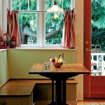 The kitchen's cozy breakfast nook boasts hidden storage.