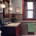 The graphic tile floor, wood wainscot, and period moldings make up a muscular treatment in a 1910 Prairie Style house—then there's the surprise of that antique mirror.