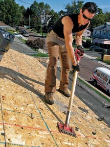 The Red Ripper, capable of taking off both shingles and nails, makes easy work of stripping old roofing material.