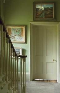 Farrow & Ball's soft Blue Gray (and oil paintings) turn a dead end into a contemplative gallery.