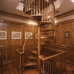 This wood stairway by Stairways Inc. opens up the third floor in a traditional house.