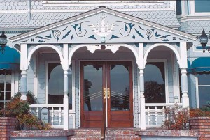 Perfection of the power bandsaw is what made intricate cutout work like this porch pediment not only possible, but affordable. Semiautomatic lathes could turn hundreds of identical posts, regardless of their complexity.