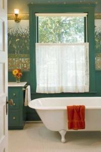 It's probably the multi-part wall treatment (used above a wood wainscot) that makes this bathroom so suited to the 1901 transitional house. The hex-tile floor, footed tub, and roller shade with lace curtain complete the coherent look.