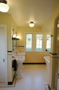 Contrasting tile treatments—and colors—give the bathroom an upscale Deco feel.