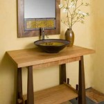 A pottery vessel sink by Suzanne Crane tops a Japanesque cabinet.