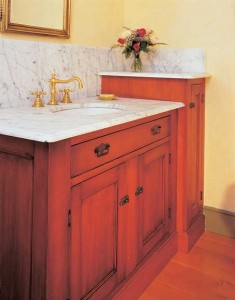 Marble, fir, and reproduction hardware make a new cabinet by Kennebec look like an original.