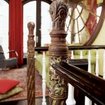 Cast-iron newel posts from an old church are eye-catching counterpoints to the stair railing's wooden spindles and rails. The time-worn patina was carefully preserved.