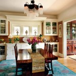 The porch was partially enclosed to create a sunroom. Note the antique glass chandelier above the dining table.