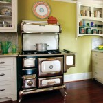 Heartland's Classic gas stove is crowned by an Italian platter. The old-style refrigerator is also from Heartland.