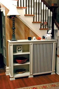 Wooden covers, such as this one from the Wooden Radiator Cabinet Co., provide an attractive way to disguise radiators, but they also cut down on output by as much as 30 percent.