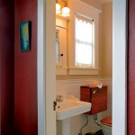 The guest bathroom's period-style makeover was inspired by the discovery of a cast iron tub underneath a laminate surround.