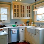 The cramped and remuddled kitchen was significantly expanded. Now, this corner functions as the cleanup area, complete with a Shaws apron-front farmhouse sink. The period authenticity is bolstered by antique light fixtures collected by Robin and Rich.