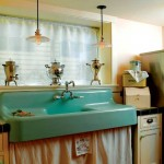 Vintage pendants illuminate the salvaged laundry sink.