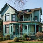 Outside, the ca. 1884 Victorian wears Rookwood Collection colors by Sherwin Williams: 'Blue Green' body with 'Sash Green' trim, a 'Terra Cotta' belt, and window sash in 'Dark Red'.