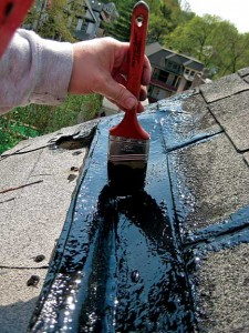 Use an ordinary paintbrush, a roller, or a squeegee to apply the activated rubber membrane along the length of the gutter, covering it completely with a thick coat.