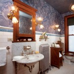 This bathroom in an 1887 Queen Anne is all new, but the detailed wallpaper, substantial bracketed marble sink, period tile, and gas-electric-style sconces help it look as if it's original to the house. (Photo: Bob Shimer; Styling: Megan Chaffin)