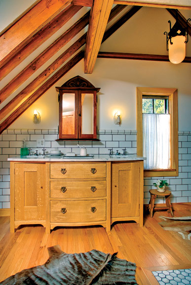 Their master bathroom's location under the gable of their 1930 Tudor house proved fortuitous for homeowners Mark Deuze and Betsi Grabe—they opened up the dropped ceiling to expose the beams, creating a cathedral-like effect.