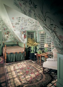 In a bedroom under the eaves at Beauport, Charles Sleepers' eclectic-fantasy-on-a-colonial-theme house in Gloucester, Massachusetts, a Chinoise tapestry paper hovers over the spool bed.