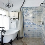 In a Dutch-inspired new old house in Pennsylvania, the artist homeowners lined the shower stalls with hand-painted tiles; these (in the master bathroom) take inspiration from vintage Delft tiles.