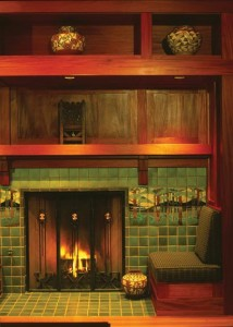 Tiled mantel surrounds were a quintessential Arts & Crafts statement. Often, they mixed solid background tiles with decorative murals—like this modern fireplace of Grueby green field tiles inset with an idyllic woodland panorama.