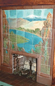 The Great Hall fireplace at Seattle's Leary Mansion depicts regional scenery—probably the Columbia River and Mt. Adams.