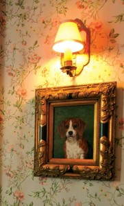 This painting of a dog—in an elaborate frame—bears a strong resemblance to the authors' late pet.