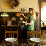 The dining room was the first space the Selenys restored. The couple removed Victorian-style, tea-stained rose wallpaper and added period-appropriate wainscoting.