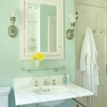 Crisp, white fixtures against a pale-aqua backdrop give the bathroom a cool, relaxing atmosphere.