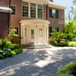 The hipped roof of the 1915 high-style Colonial Revival pays tribute to the earlier Federal style that inspired it.