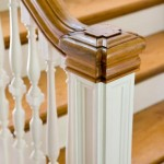 Thin, turned balusters and a squared newel post are indicative of the period.