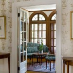The sitting room's triple Palladian windows nod to the elegance of the Federal style while flooding the space with natural light.